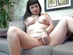 Carrie Ann is a raven haired tattooed milf with heavy