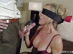 Big-titted lingerie-clad mummy Brandi Enjoy is blindfolded to make her