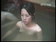 Youthful nude Asians in the public bathtub are luxurious