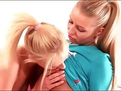 Beautiful youthfull blondes kissing in bed