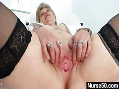 Big-titted granny in uniform opening up her aged pussy