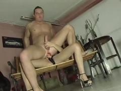 Brunette sucks cock and dovetail uses a strapon at hand fuck his bore
